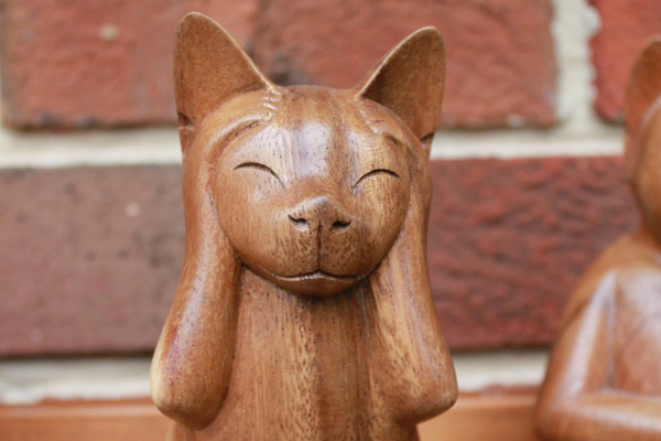 Wood carving of a cat