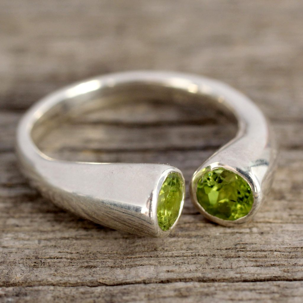 Handcrafted Jewelry Silver and Peridot Wrap Ring from India, 'Face to Face'