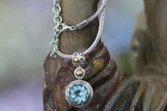 Gold accent topaz pendant necklace, 'Blue Bali'