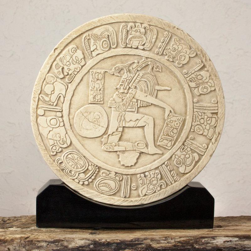 Maya Ball Game Surrounded by hieroglyphs an ancient ball player demonstrates his skill and strength. Aztecs and Maya