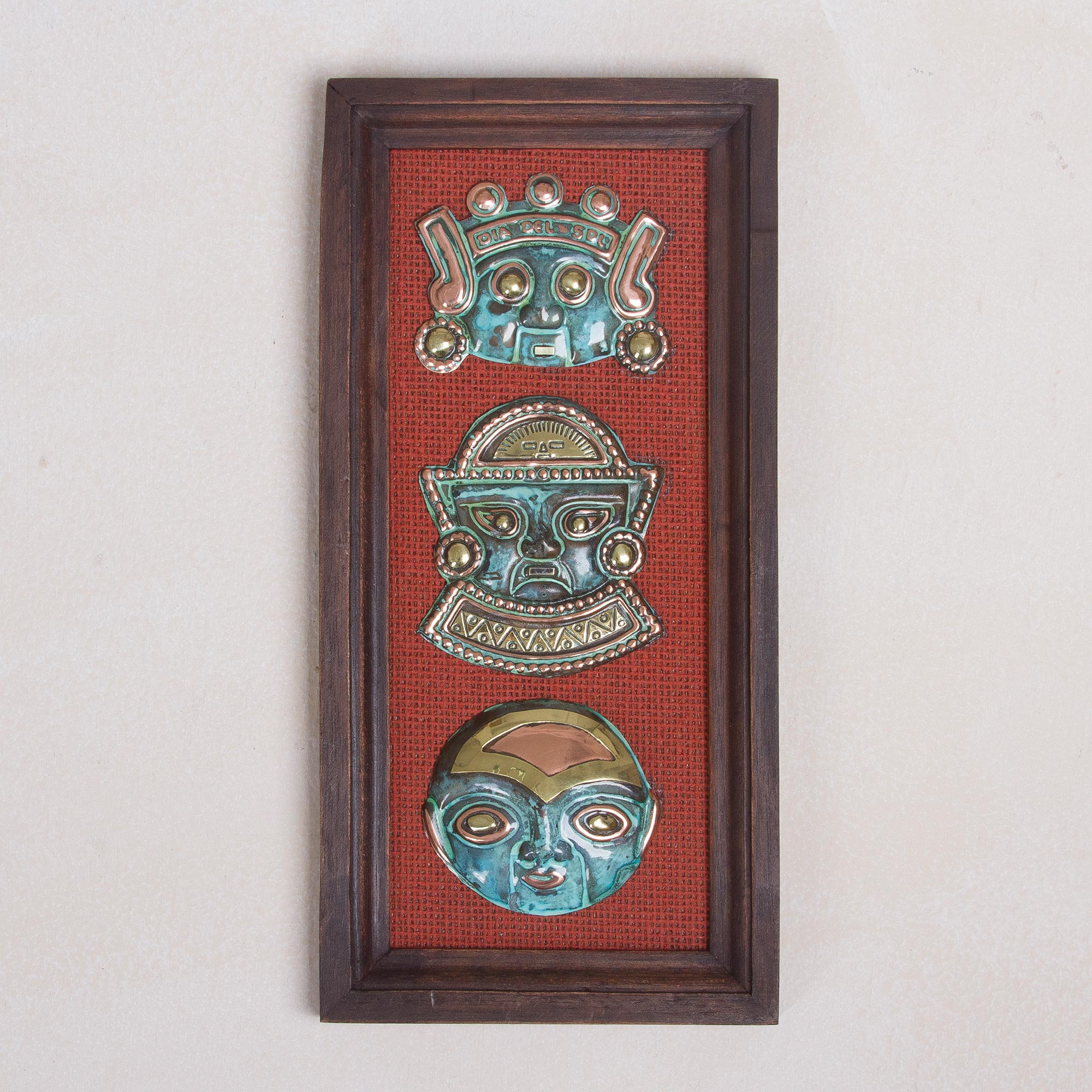 Peruvian Culture Copper and Bronze Wall Sculpture of Ancient Masks from Peru Pairing Area Rugs