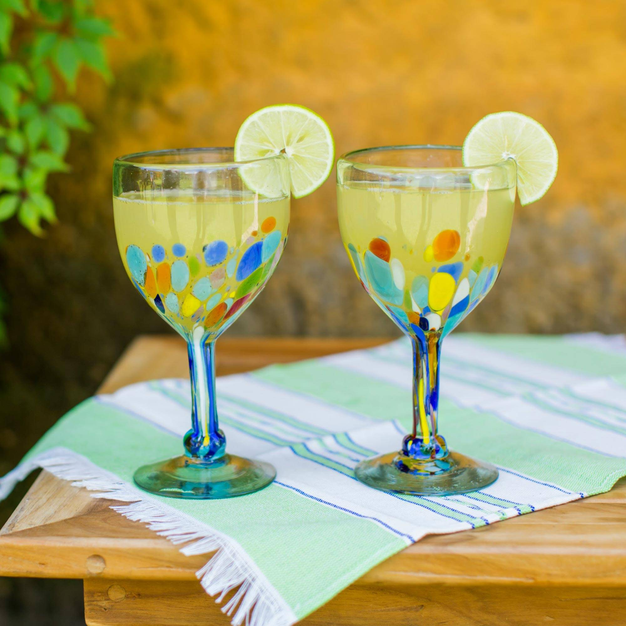https://www.novica.com/p/hand-blown-colorful-8-oz-wine-glasses-set/256164/
