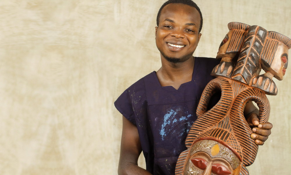 Victor Dushie - Hand-carved wood masks and sculptures - West Africa